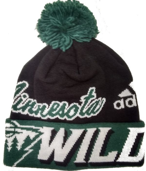 0a52f1e01c4 NHL Licensed Minnesota Wild Stocking Cap is made by adidas. The hat is  black and green and wraps around with the Wild Team name and logo along  with the ...