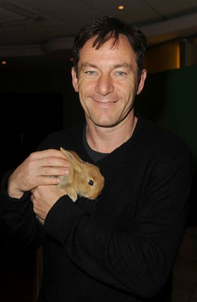 I've found my calling. Here is Jason Isaacs looking adorably worn and HOLDING A BUNNY.