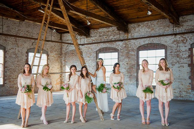 Bridesmaids in pink lace dresses