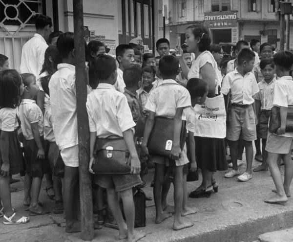 """Watchtower"", being distributed in streets of Bangkok. 1950"