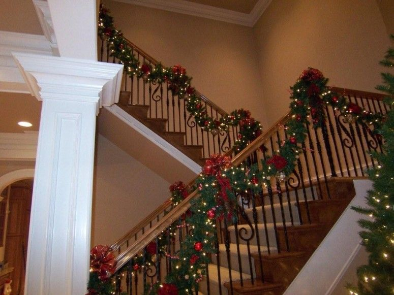 Interior Designing. Beautiful staircase handrails with nice garland for amazing Christmas interior decoration ideas. Must See: Amazing Home Interior Designing for Wonderful Christmas Holiday