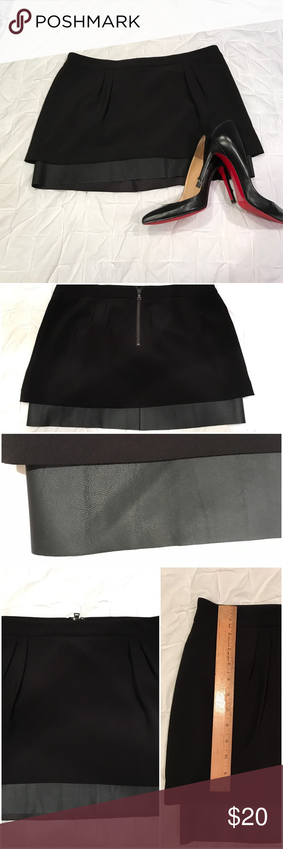 Express Mini Skirt with Faux Leather Trim Express black mini skirt with a pop of faux leather- super sexy! The faux leather trim (100% polyester with polyurethane coating) is on the bottom of the lining. The skirt/shell is made of 93% polyester, 7% spandex. Zip back, size 12. I only wore this once and forgot I had it, which means it's time she gets a new home to be rightfully shown off! Express Skirts Mini