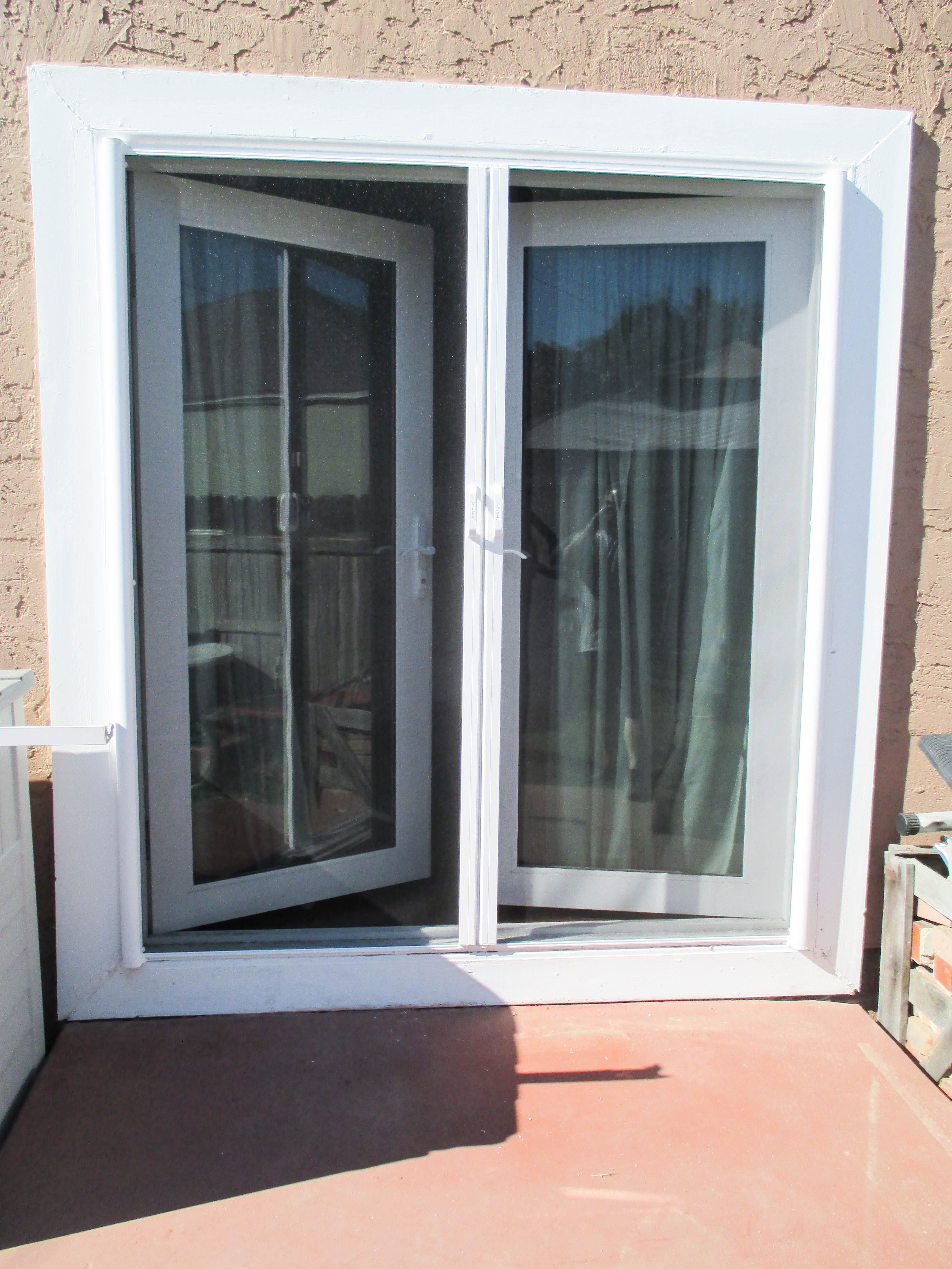 If You Have A Set Of French Doors Upgrade From Traditional Screen Doors To Retractable Screen Doors Kee Retractable Screen Door House Bugs Retractable Screen