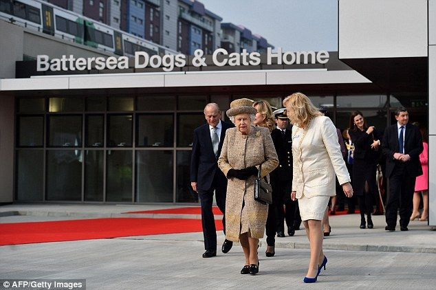 The Queen meets David Gandy during visit to Battersea Dogs