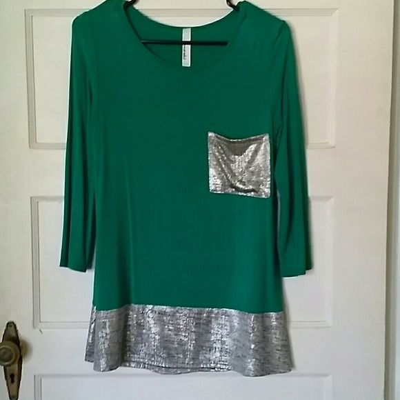 Boutique top with silver pocket and trim Pretty top with silver pocket and trim. Size Small. 3/4 sleeve. Worn once! Tops Tees - Short Sleeve