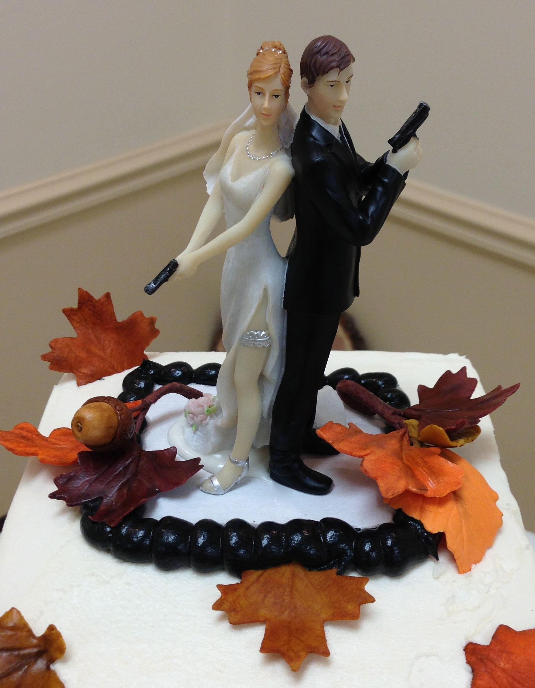 Unique topper.  Sugar paste leaves.  #Fall weddings # fun wedding topper