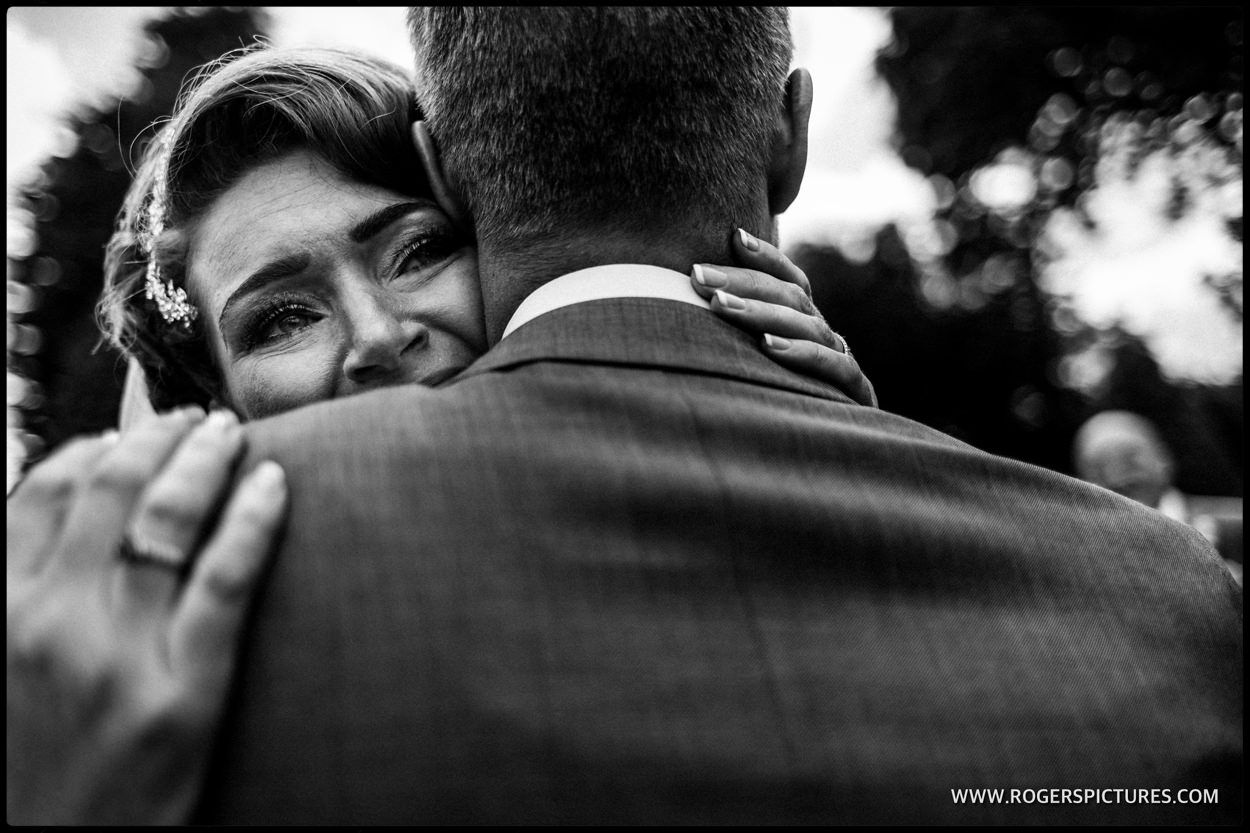 An emotional hug for Emma and Dean right after getting married at Ridge Farm -