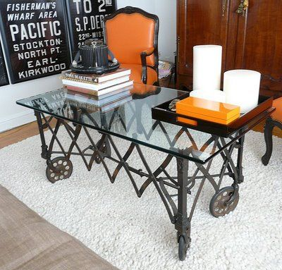 Antique casket stand turned into a coffee table right up my