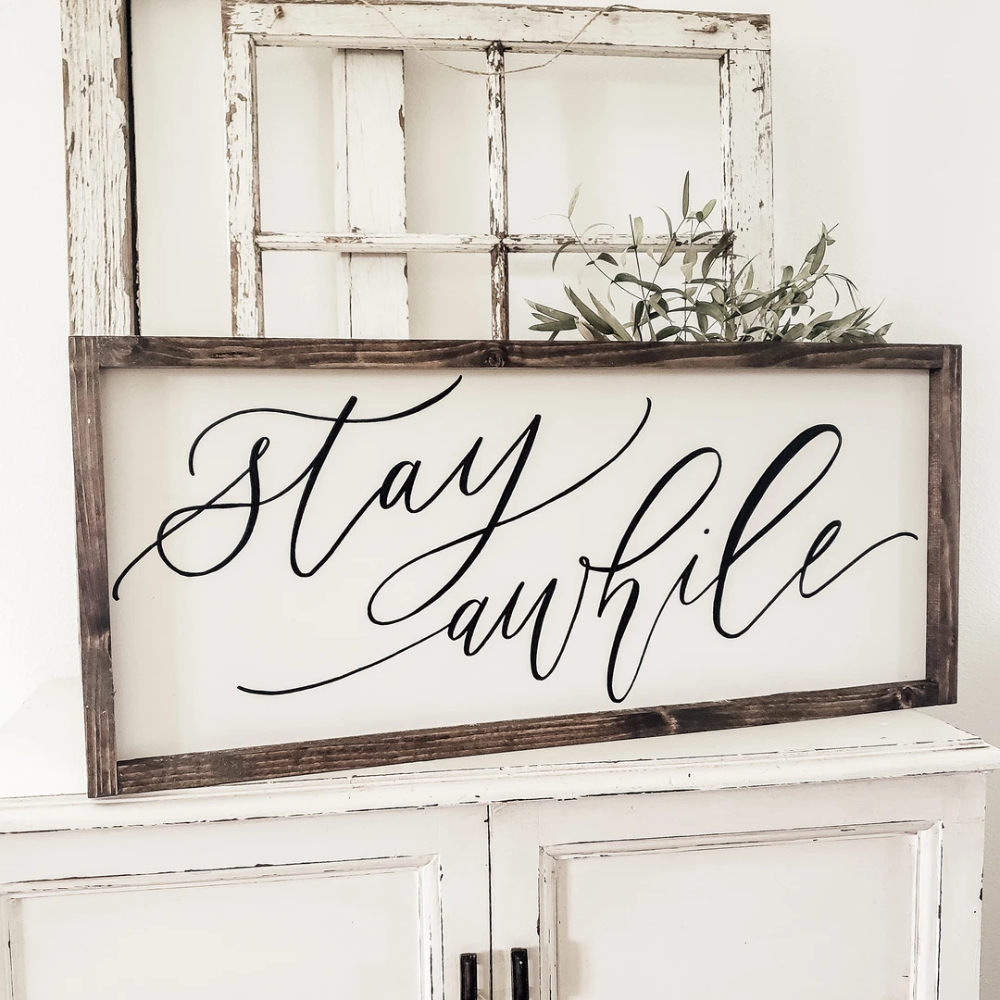 Stay Awhile wooden framed sign