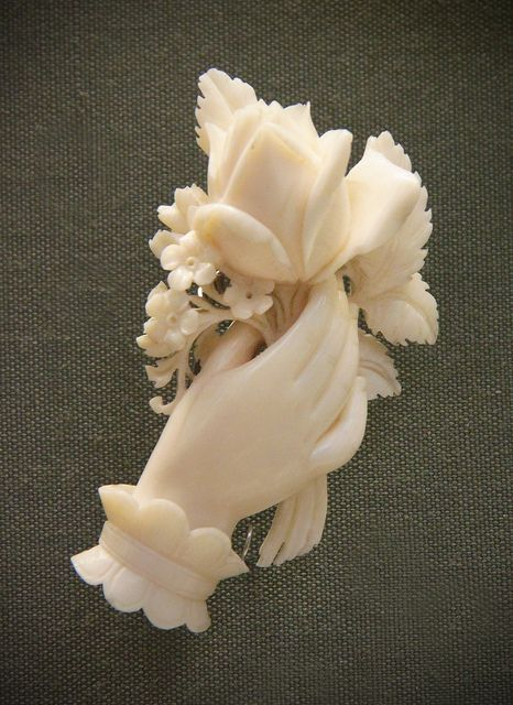 Carved ivory bouquet and hand brooch, English(?), mid-19th c