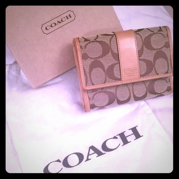 New authentic coach signature compact khaki wallet New authentic coach signature compact khaki wallet. Comes with original box and authentic coach dust bag to store wallet. Coach Bags Wallets