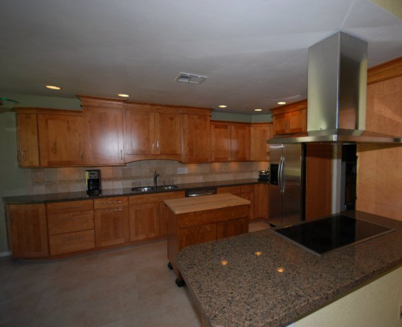 KraftMaid Maple With Toffee Stain And Granite Countertops.