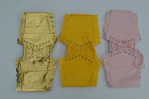 Lace Up Vinyl Cincher With Snap Closure Back - 3 Colors Available Can be taken in on both sides. Colors: Gold Metallic, Yellow, and Light Pink One Size.