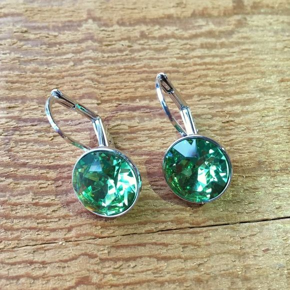 a6a146323 Earrings made with Swarovski Bella mini crystal Brand-new, never worn Swarovski  crystal earrings in a beautiful peridot mini bella style silver setting.