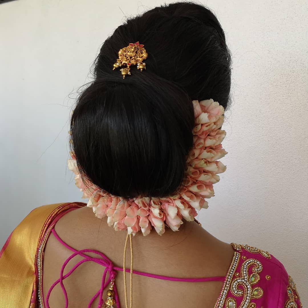 A Simple Chignon Bun With A Baby Pink Rose Petal Kondai Malai Chignon Bun Chignon Beautiful Hair