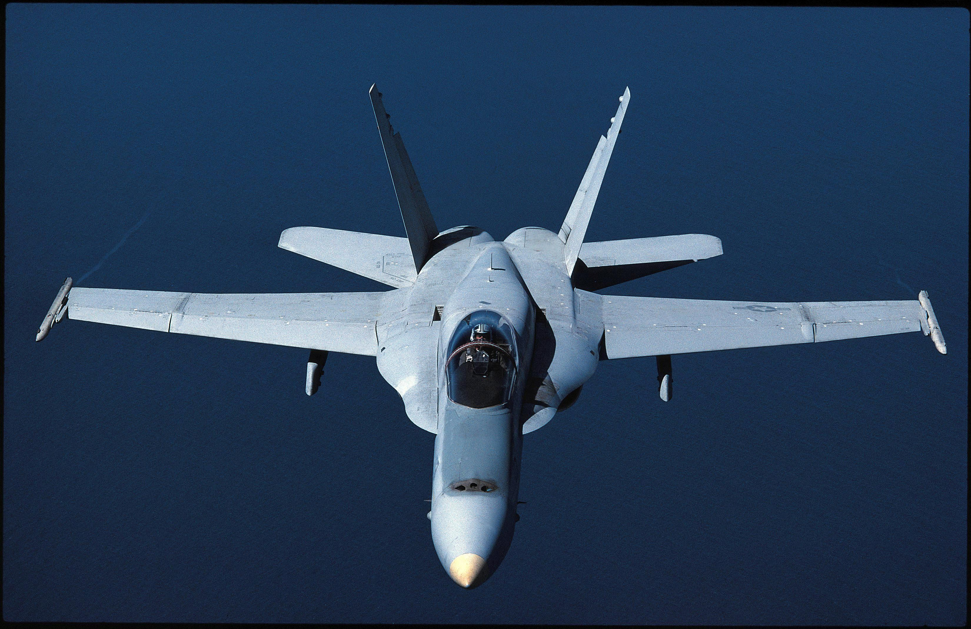 The F/A-18 Hornet has a top speed of Mach 1.8. When traveling at ...