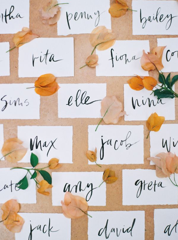 place card calligraphy - photo by Sarah Kate Photographer and Joshua Aull Photography http://ruffledblog.com/mexico-city-courtyard-wedding-ideas