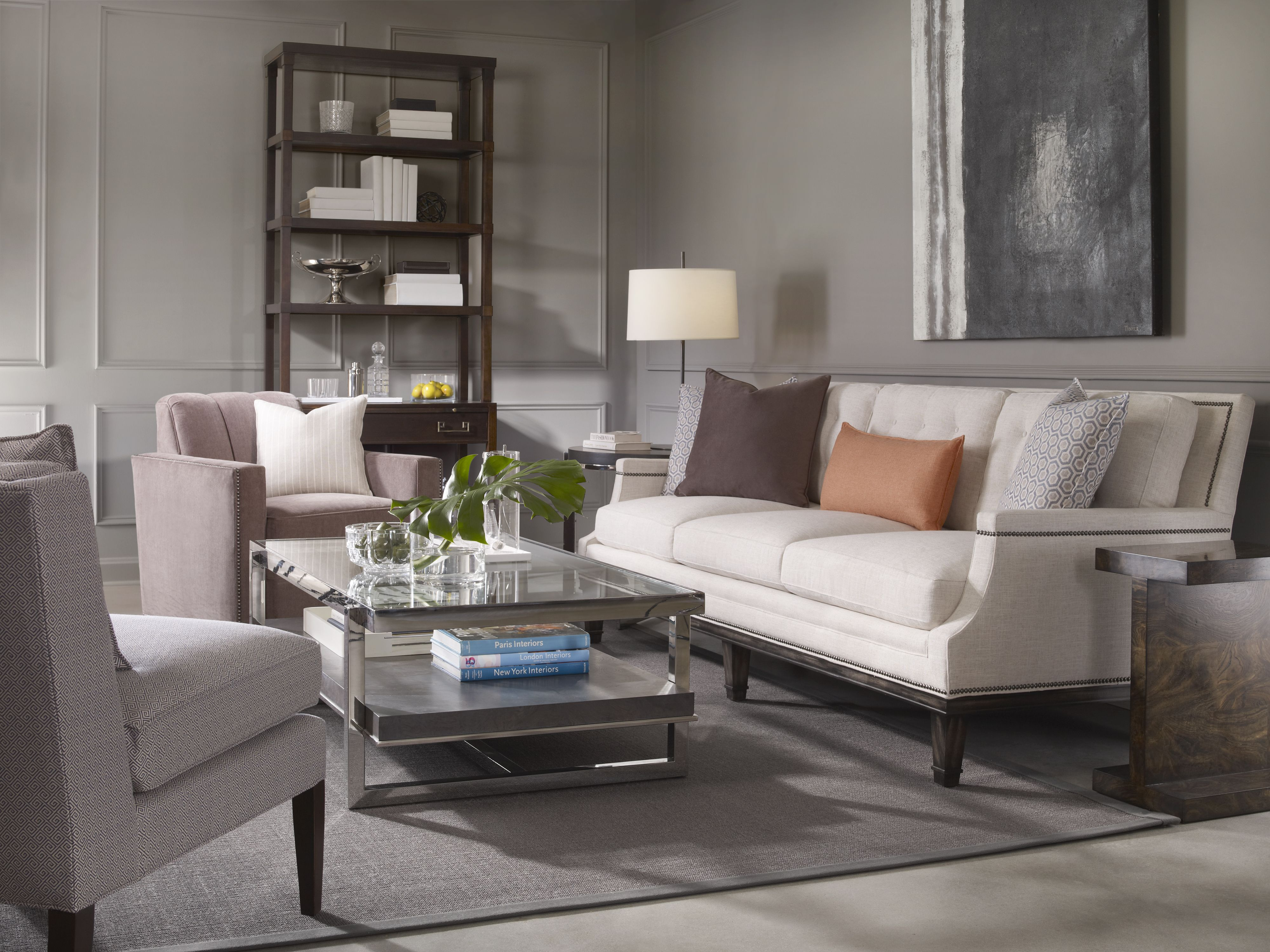 Recliner Sofa glass and metal cocktail table with customizable upholstery and bookcase end table