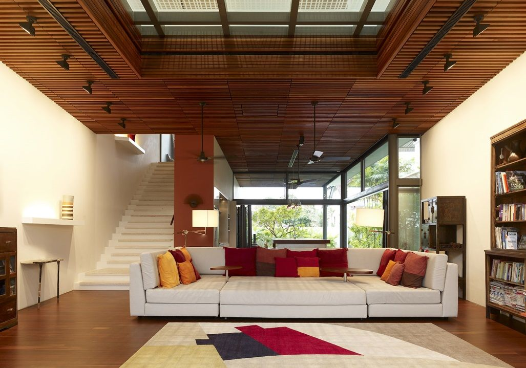 Wood clad drop ceiling panels contrast the white walls and provide
