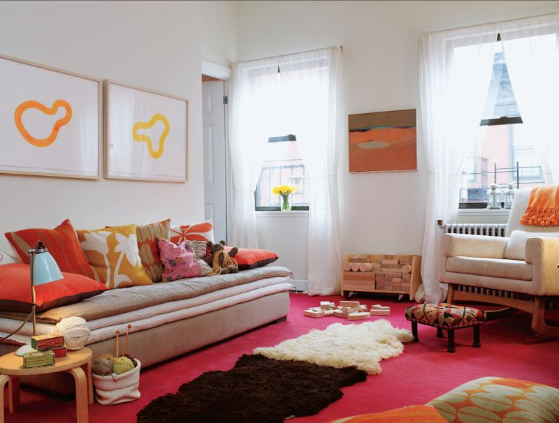 Layering Rugs Over A Red Carpet Brings Your Eye Up To The Great Pillows And Art On Walls Neutral Chair Couch Look Cozy