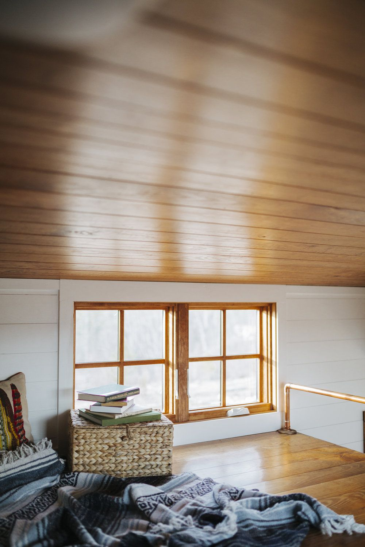 Loft bedroom windows  The Monocle by Wind River Tiny Homes  loft wood clad windows