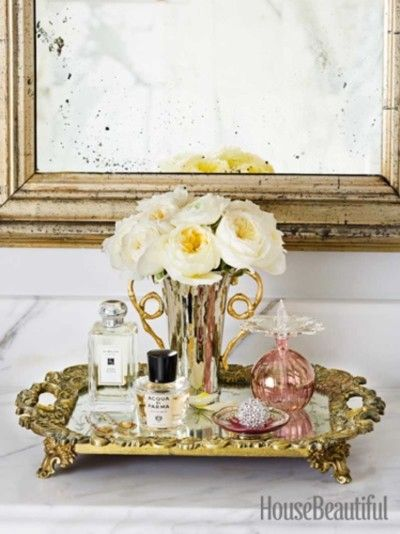 table in your bathroom beside large whirlpool i would add bath accessories jars as well mirror trayvanity