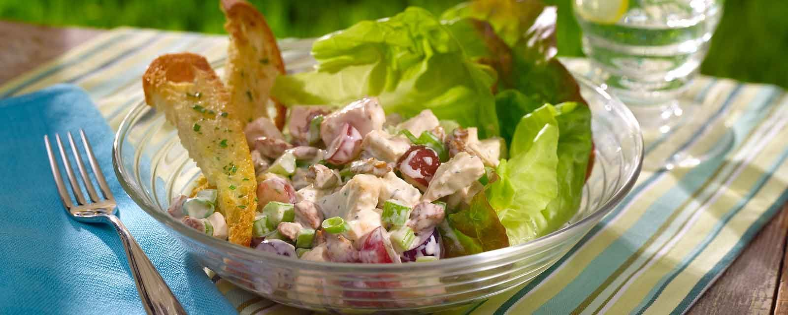 1. In a large salad bowl, toss the lettuce, pears, apples, grapes, celery, blue cheese, together with the dressing until lightly coated. Garnish with the walnuts and serve.