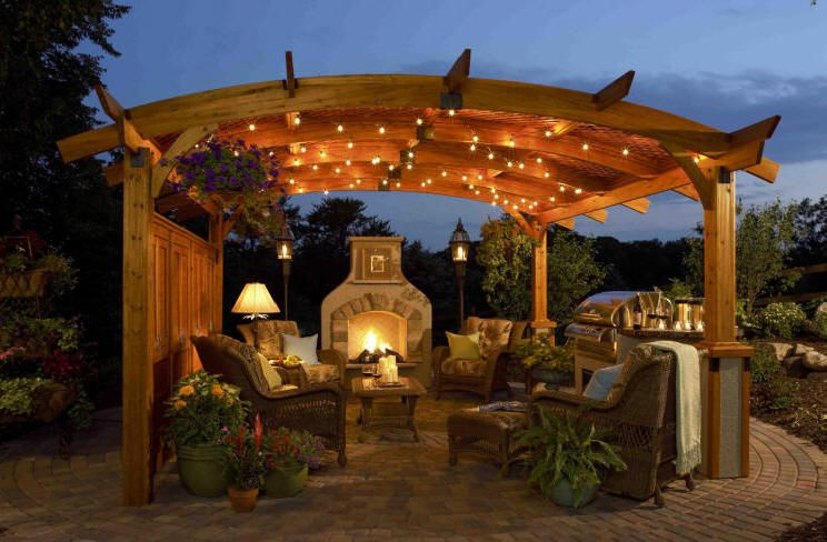 Outdoor fireplace and patio design pavers set in a radius pattern to define the space outdoor kitchen outdoor fireplace patio furniture and a pergola