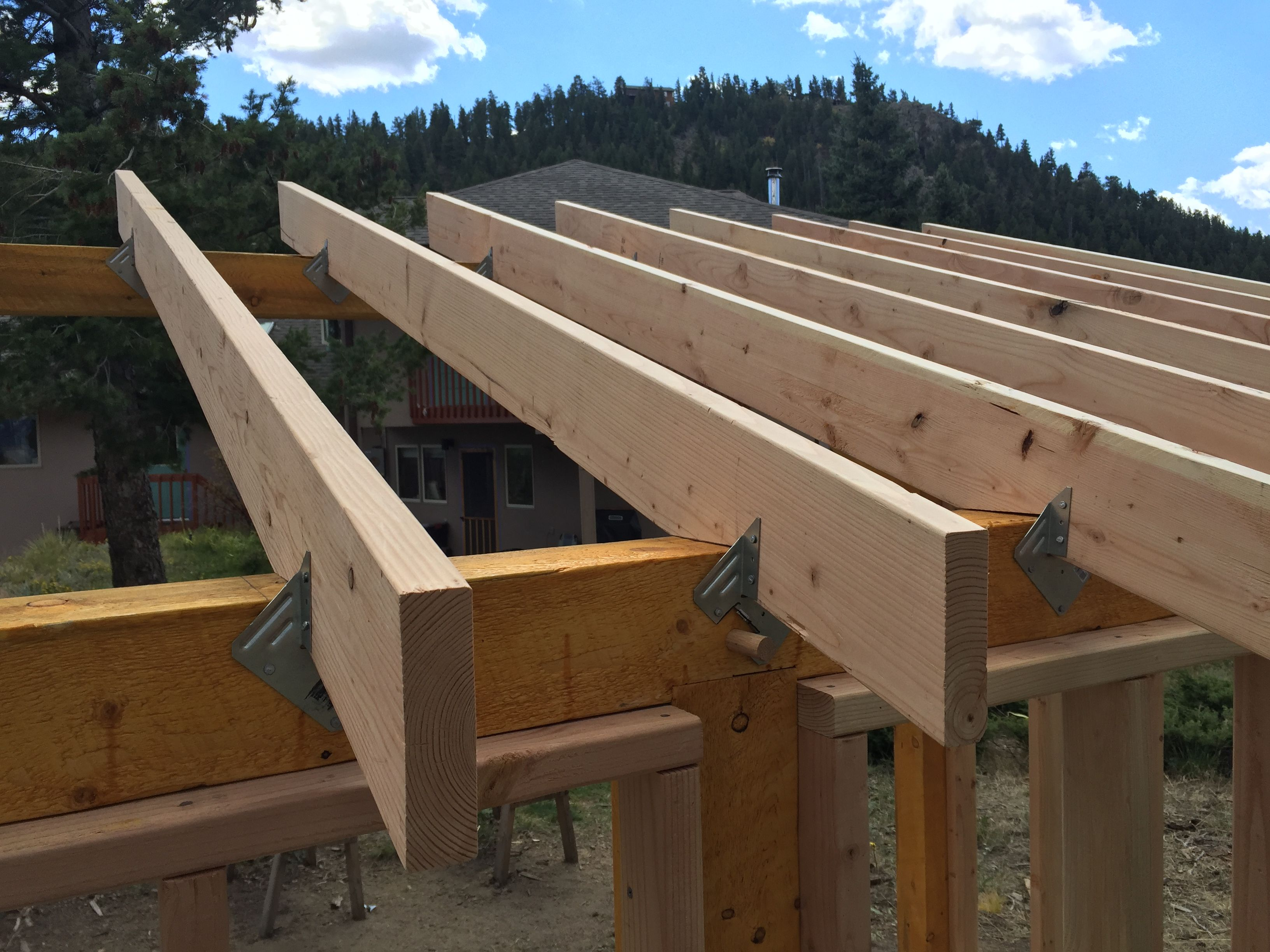 2x8 rafters are secured with hangers hurricane clips for Best house design for hurricanes