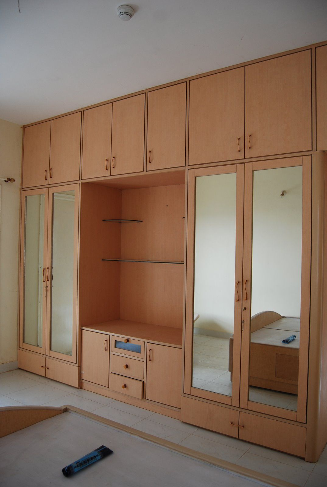 Bedroom Wardrobe Design. Tips For Wardrobe Design. Brown Polished ...