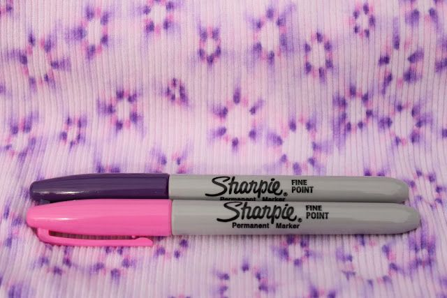 Sharpie tie dye - make dots to make a flower and then spray or drip rubbing alcohol to make them spread