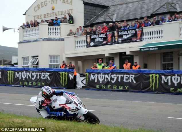 Bird Strike! Isle of Man TT rider ducks for cover as low-flying sea gull collides with his ...