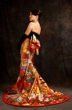 Designer Anna Niponica take traditional Japanese Wedding Kimonos and redesigns them into Western dresses.