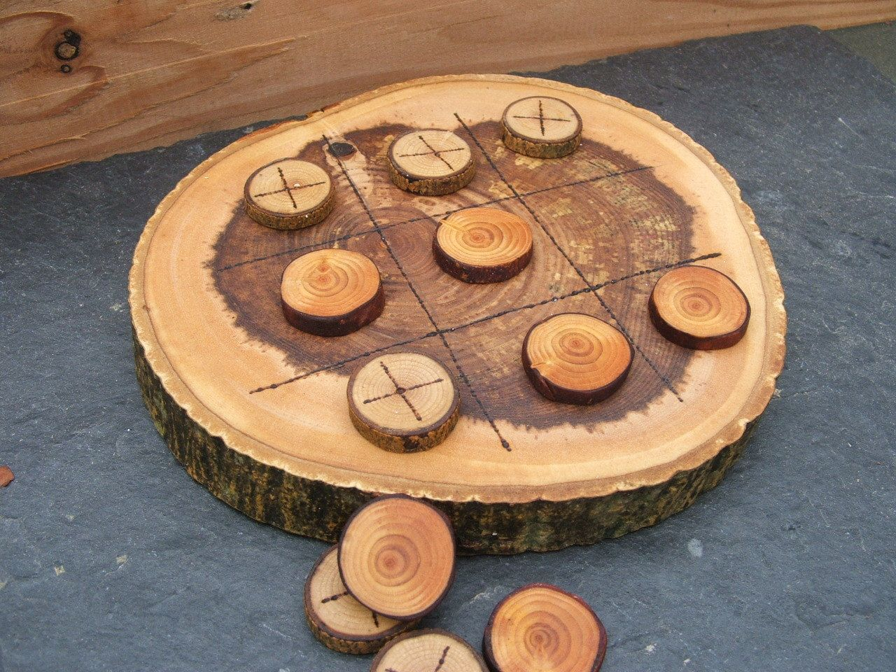 Natural rustic wooden tic tac toe or noughts and crosses game tic