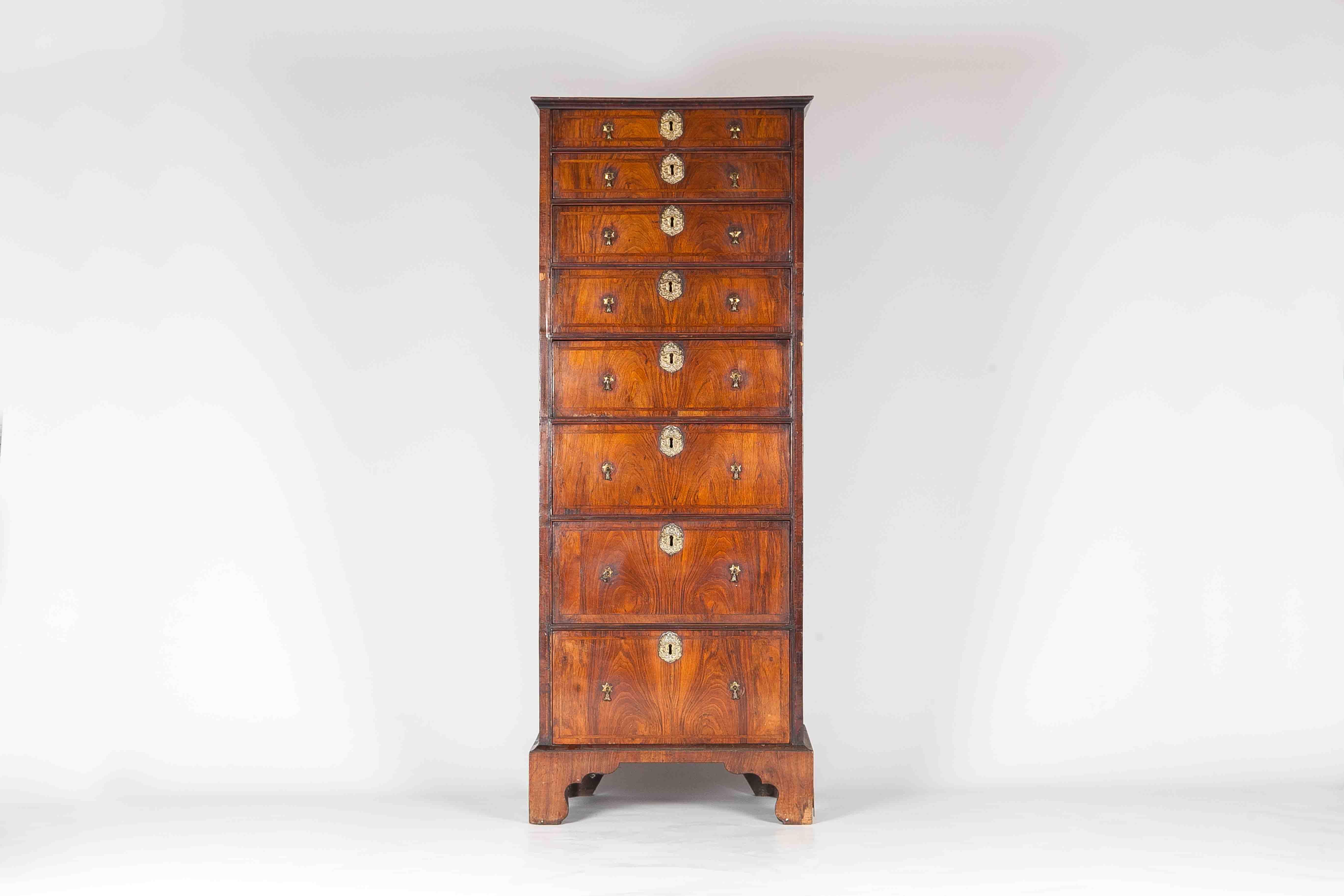 An Irish walnut eight drawer Tallboy. Ex collection