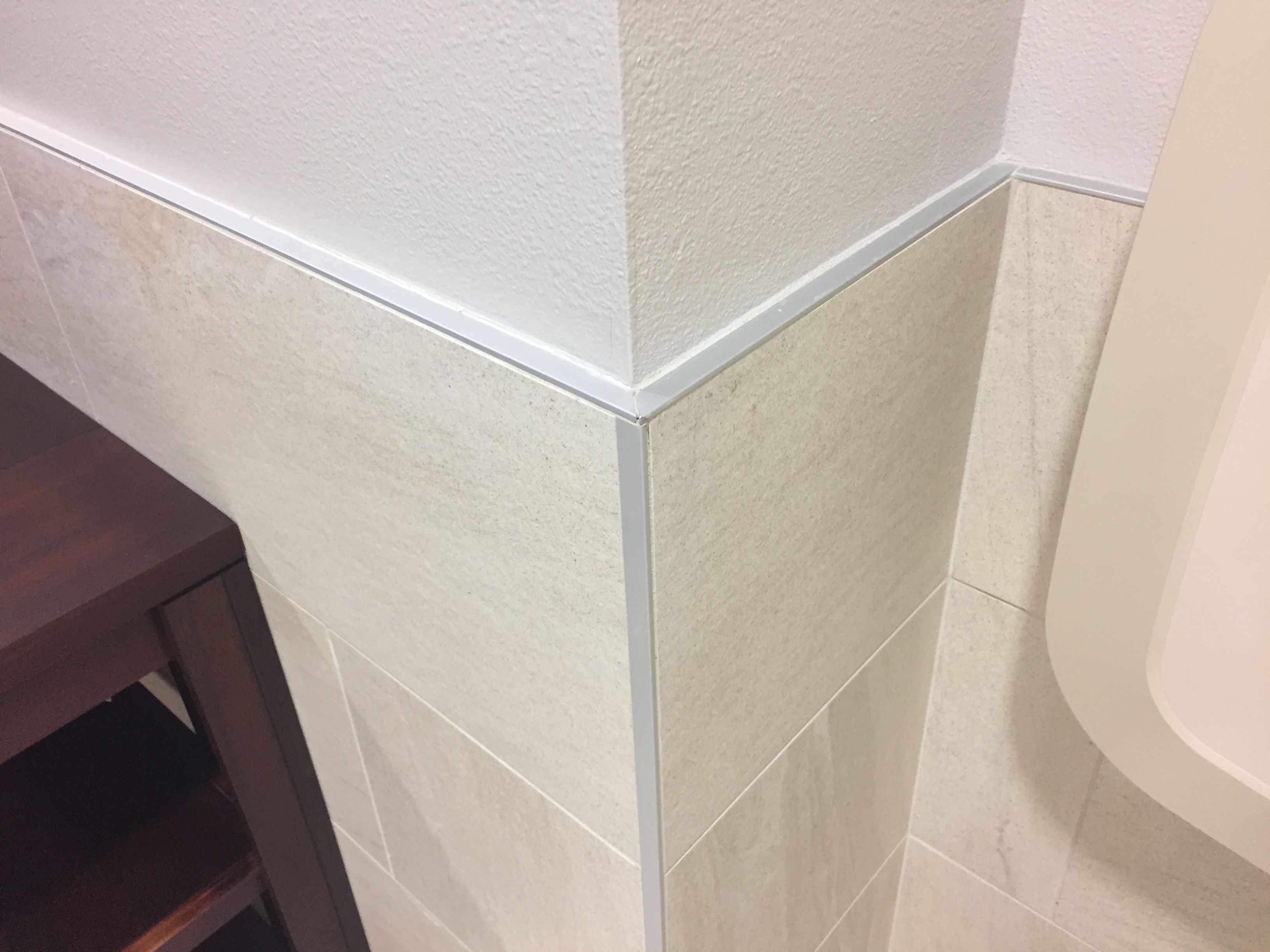 Schluter Cap And Corner Tile On Ceramic Tile Wainscot At