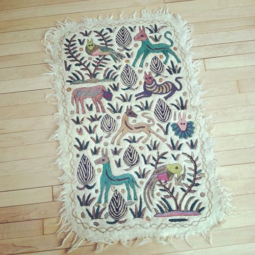 would be fun to make a rug like this with animals as symbols to represent my favorite memories :)