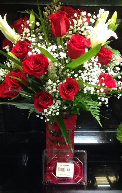 2 dozen roses, baby's breathe, lilys