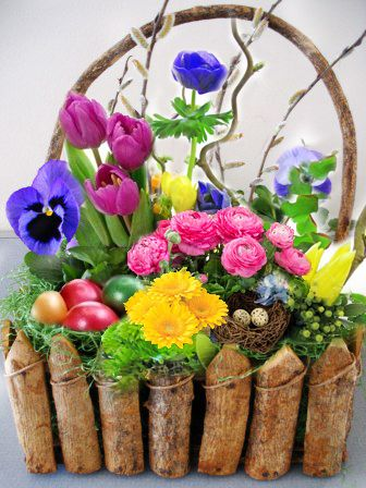 Attractive colorful easter basket full of flowers easter attractive colorful easter basket full of flowers negle Image collections
