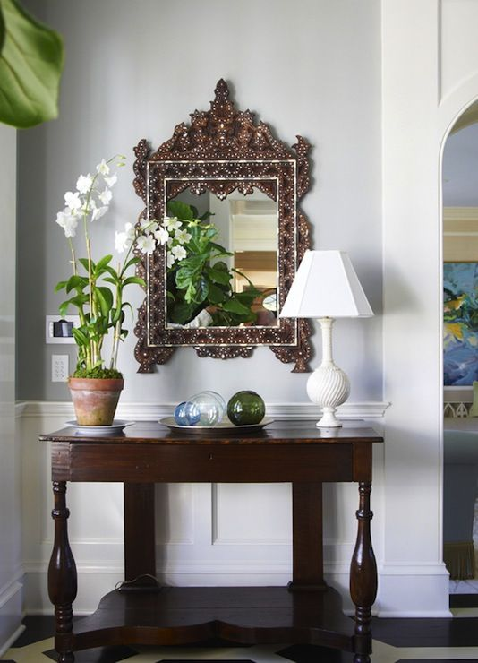 Foyer with antique console table, bone inlay mirror, white simple ...