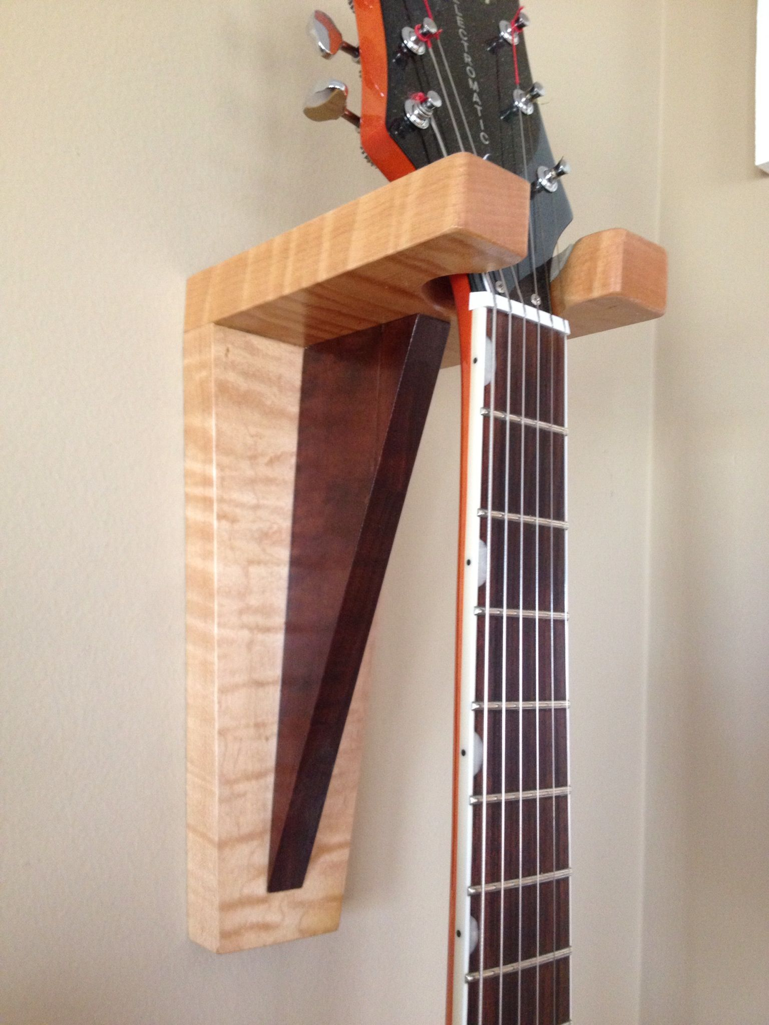 Guitar hanger in curly maple and walnut