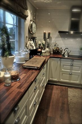Wow! Love the white cabinets an the wood counter tops, I want this in my kitchen!