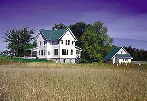 A big white farmhouse in the middle of nowhere yes
