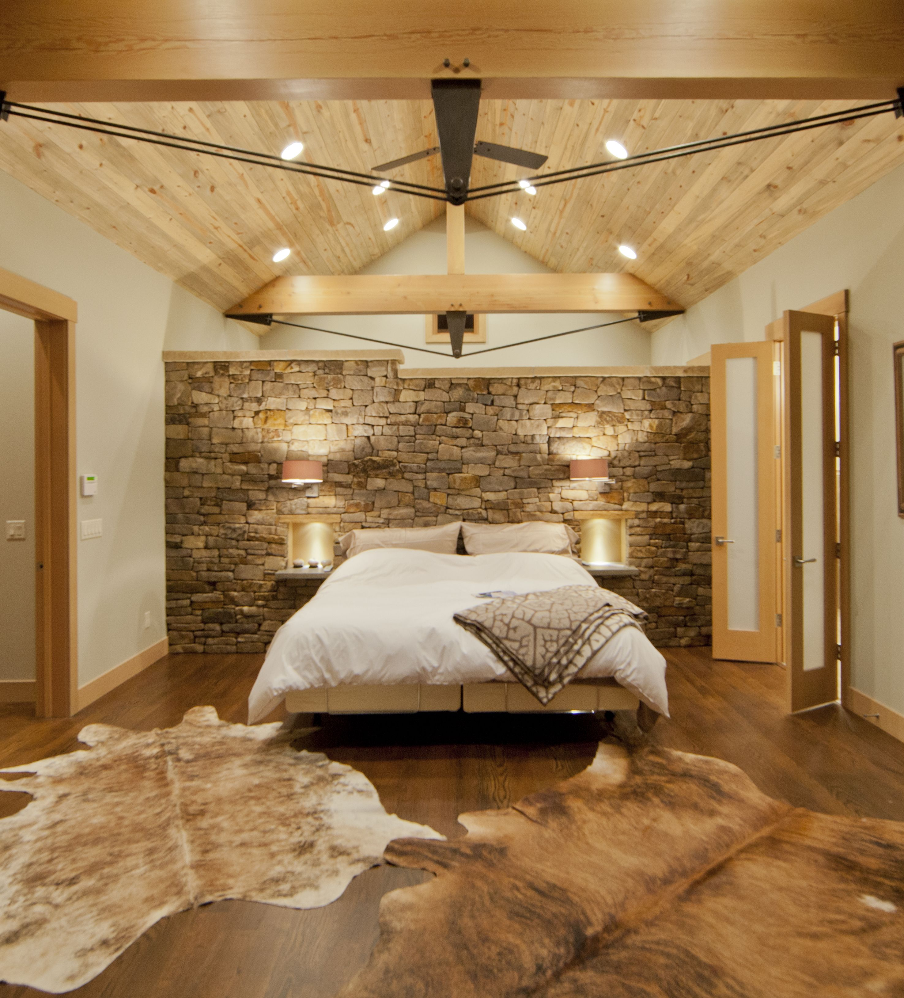 Contemporary master bedroom with exposed beams, wood tonged and