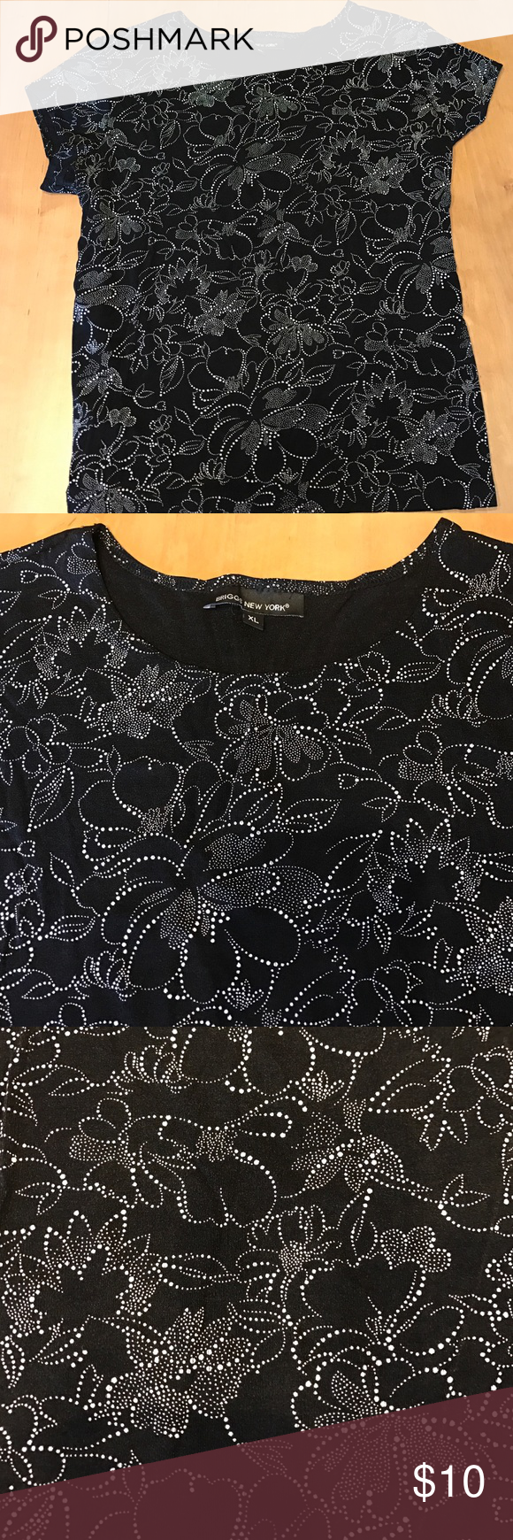 Briggs New York sz XL stretchy sexy top! Great shirt in like new condition. Comes from a pet free smoke free home. Purchase a few for a discount! Tops Blouses