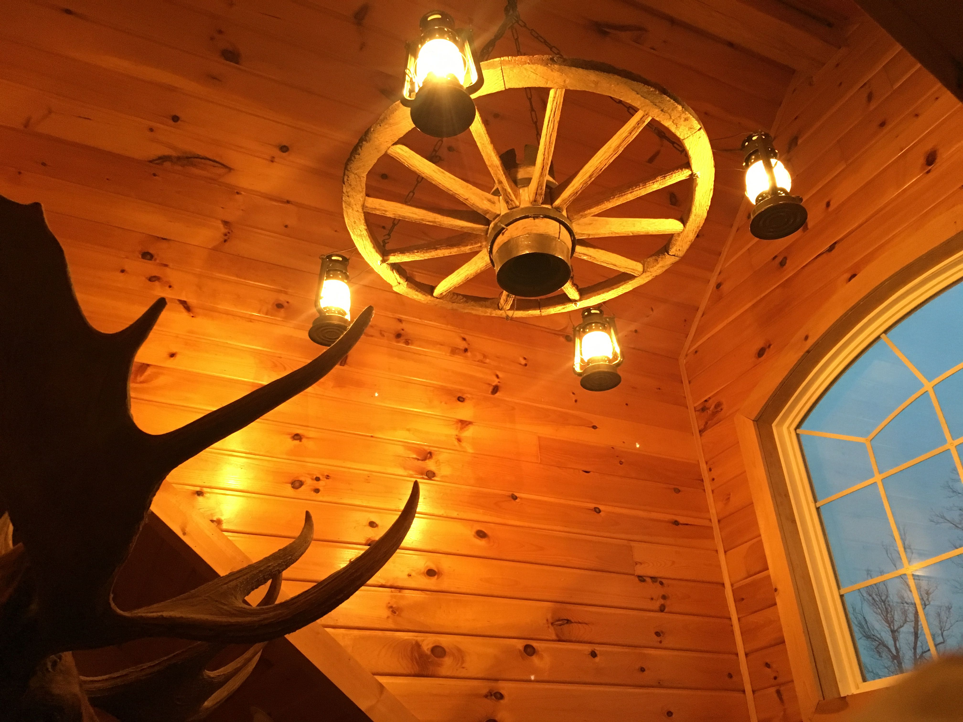 Pin by Colt on Wooden wagon wheel chandelier Pinterest