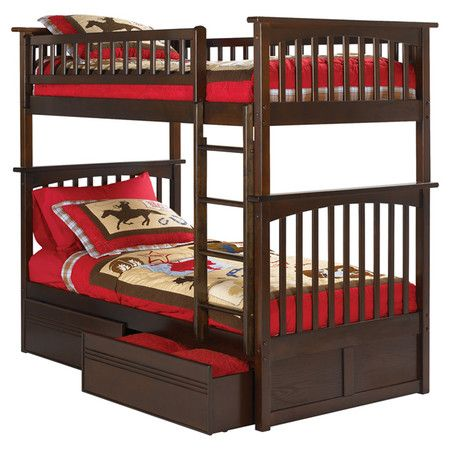 Bunk bed with two storage drawers. Converts into two beds.   Product: Bunk bedConstruction Material: Wood
