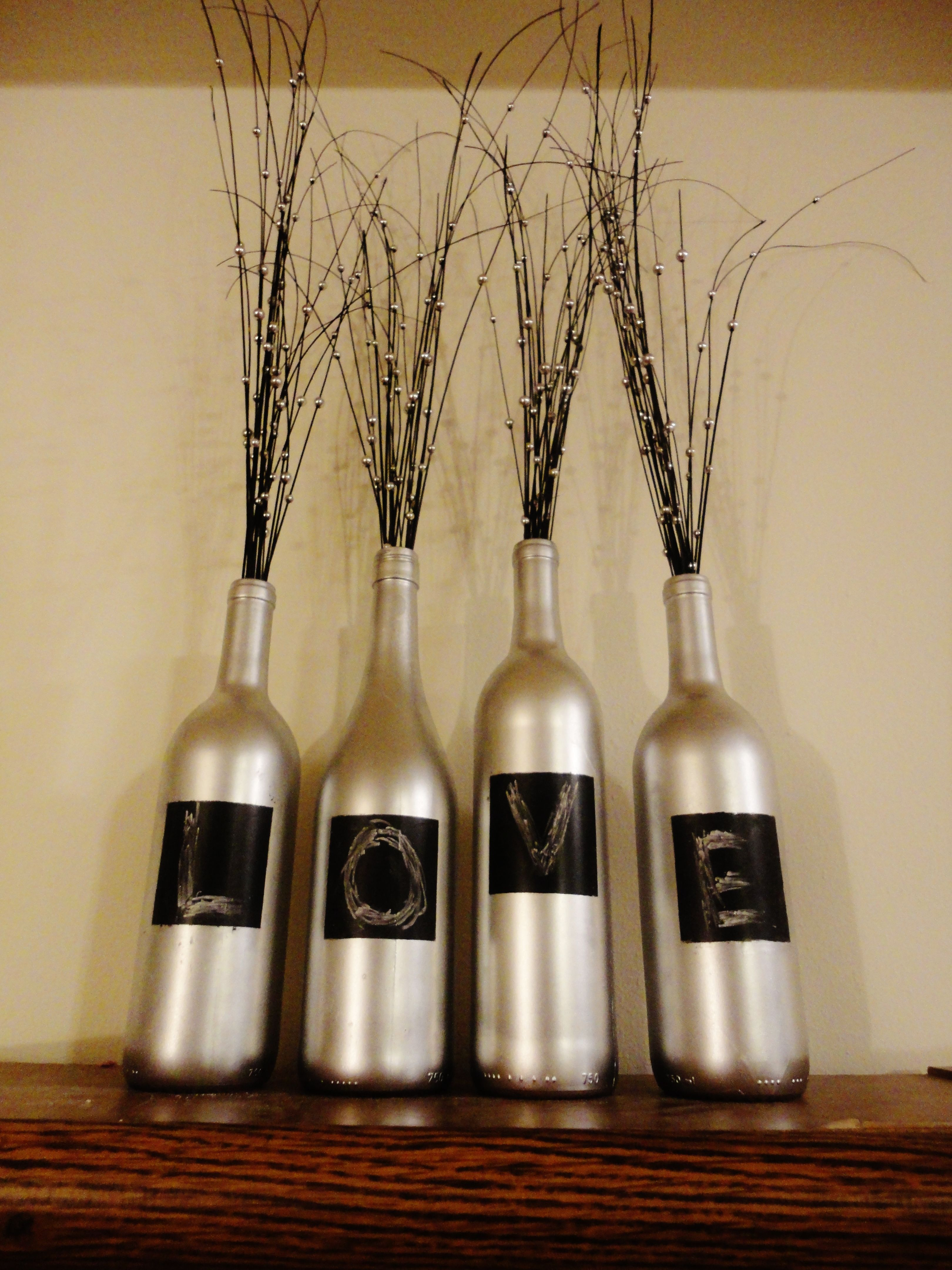 Spray painted wine bottles with chalkboard paint squares. you can change the word whenever you want!