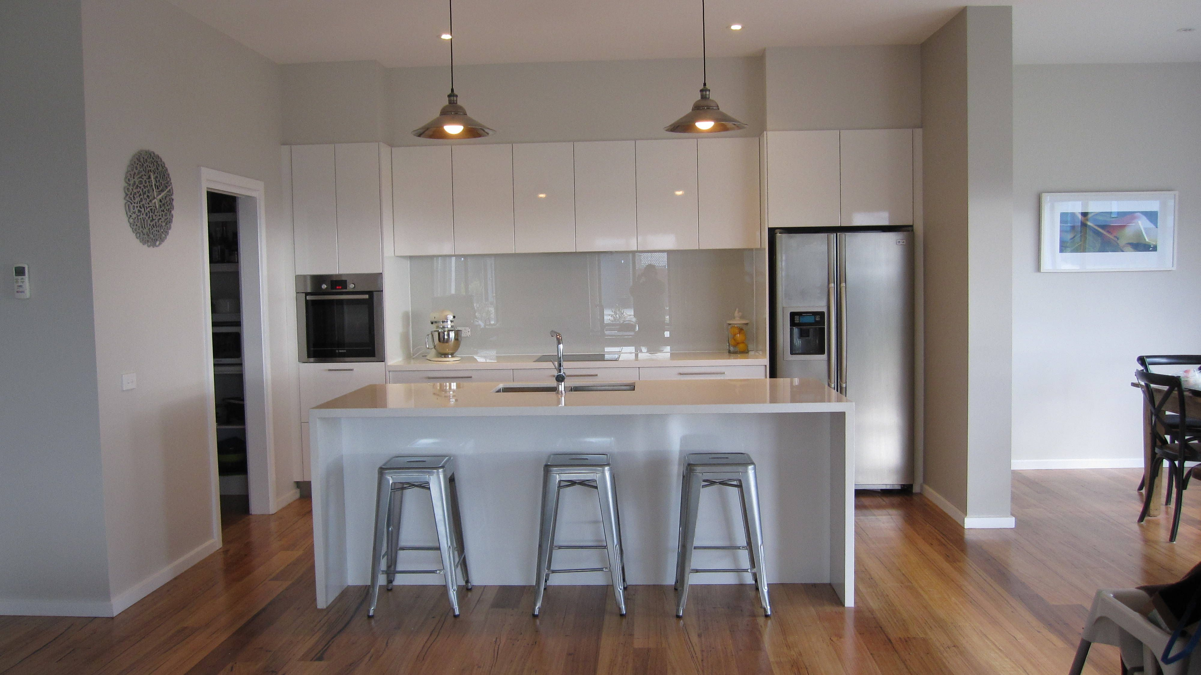 white on white overhead cupboards waterfall island no. Black Bedroom Furniture Sets. Home Design Ideas