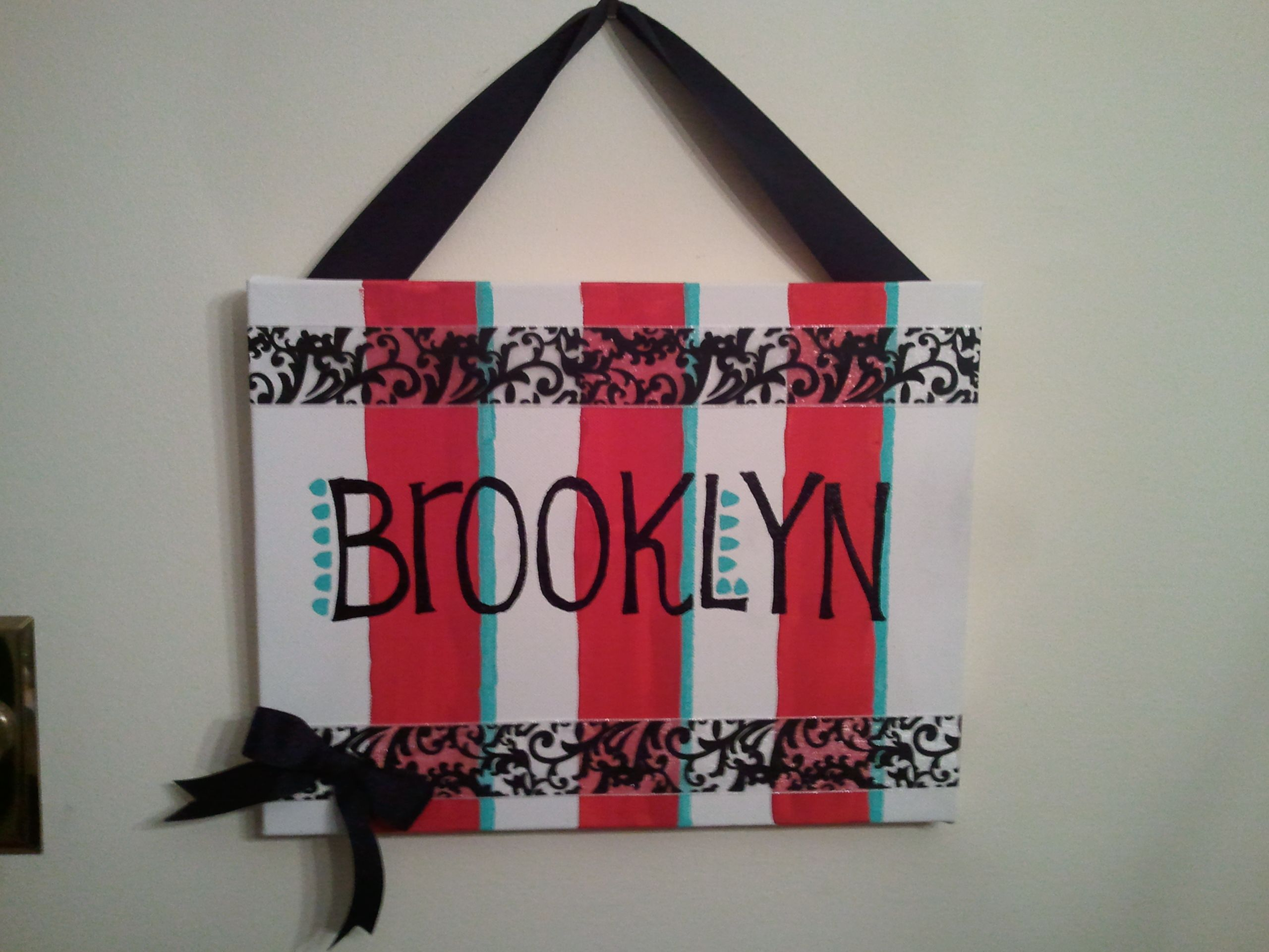 Easy to do with canvas, painter's tape, ribbon and acrylic paint. Perfect for a baby shower gift!